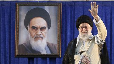 Iran's Supreme Leader Ayatollah Ali Khamenei waves to the crowd.