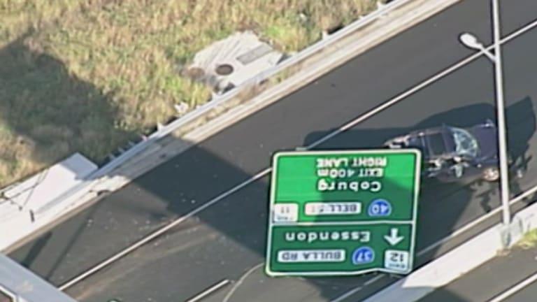 The crumpled sign on the Tullamarine Freeway.