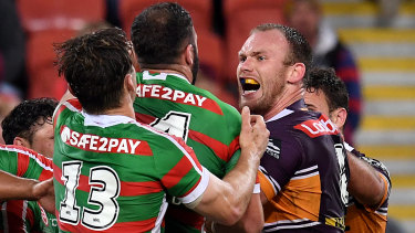 Broncos prop Matt Lodge confronts Rabbitohs players during a fiery clash at Suncorp Stadium on Friday night.