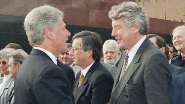 Former Dutch prime minister Wim Kok, right, shakes hands with US President Bill Clinton in 1995 in Moscow's Red Square.