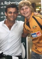 A young Will Pucovski with one of his cricketing idols, Adam Gilchrist