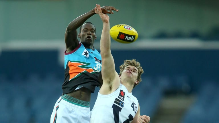 Charge: Tony Olango (left) competing in the AFL Under 18 Championships in 2016.