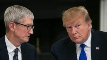 Tim Cook, CEO of Apple, speaks with US President Donald Trump.