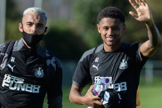 Florent Indalecio with Newcastle youngster Adam Wilson at training.