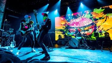 Regurgitator on stage during their  performance at the Tivoli in Brisbane.
