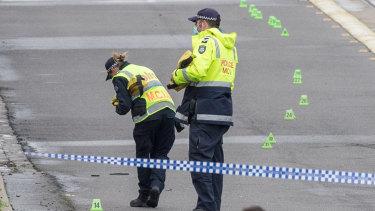 Police investigators at the scene of the crash.