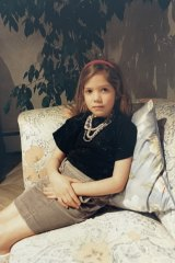 Lucy, aged 5, in  London wearing her  mother's jewellery.