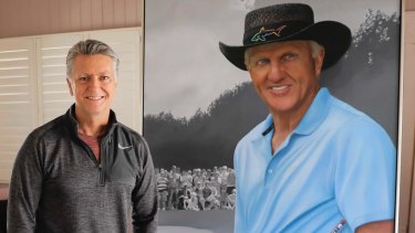 Queensland artist Tom Macbeth with his portrait of Australian golf legend Greg Norman.