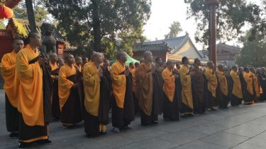 Monks attend the ceremony at the Shaolin Temple.