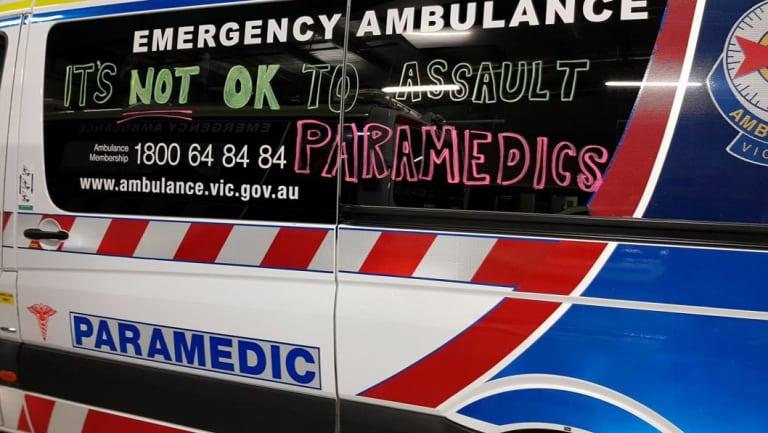 An ambulancecarrying the message that it's 'not OK to assault paramedics'.