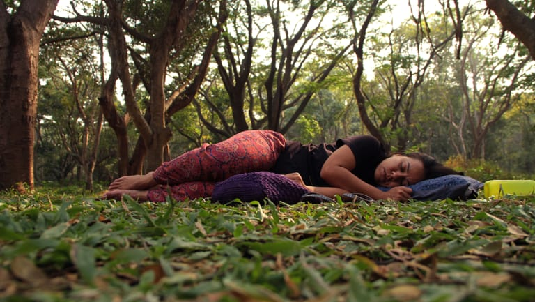 "A woman ""sleeping"" in a park in Bangalore, in a protest aimed at reclaiming public spaces for women."