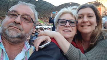 Sasha Petrova and her parents at a Paul McCartney concert in 2017.