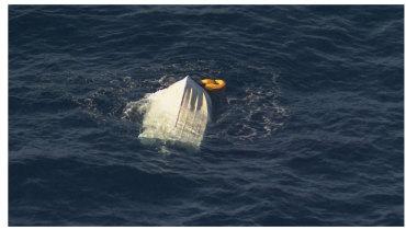 The capsized boat off Port Kembla.