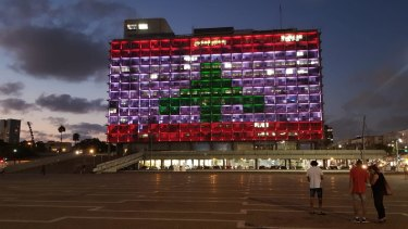 City Hall in Tel Aviv's Rabin Square was lit up in the colours of the Lebanese flag on Wednesday.