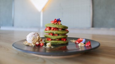 An Instagram friendly matcha pancake stack with chocolate sauce at Matcha Mylkbar.