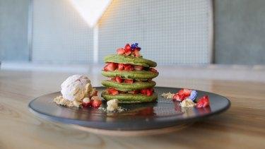 An Instagram friendly matcha pancake stack with chocolate sauce at Matcha Mylkbar.