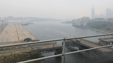 Sydney skyline is barely visible through the smoke haze.
