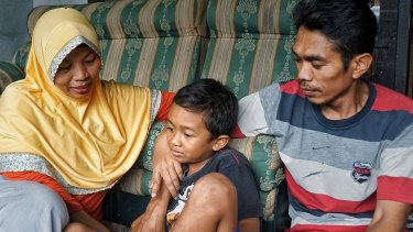 Baiq Nuril Maknun, her son Rafi and husband Lalu Isnaini.