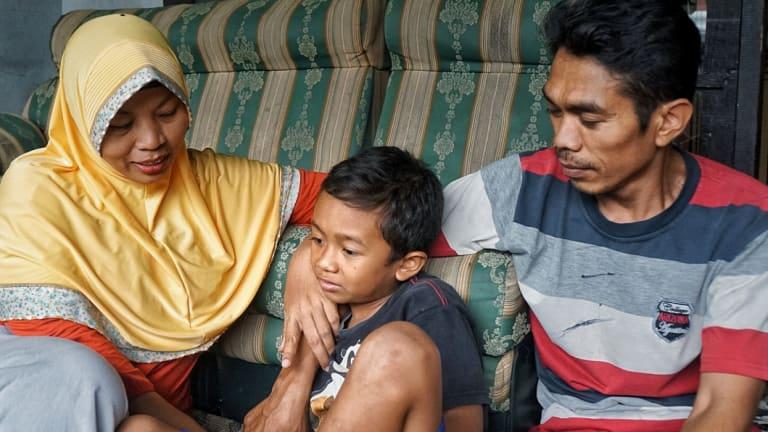 Baiq Nuril Maknun, her son Rafi and husband Lalu Isnaini.