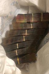 Cash seized by police investigating the drug seizure.