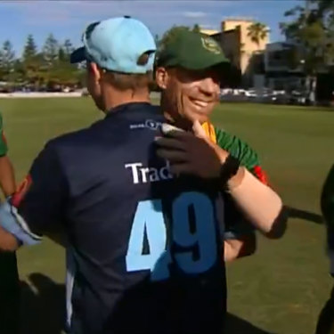 Smith and David Warner embrace after a match between Sutherland and Randwick Petersham in the summer.