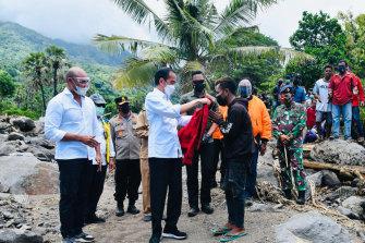 Indonesia president Joko Widodo inspects damage atAmakaka village in the province of East Nusa Tenggara on Friday.