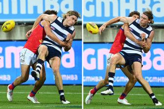 Geelong'sMark Blicavs tackles Lion Zac Bailey,
