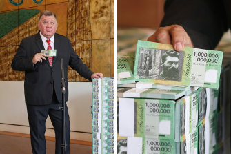 """Craig Kelly with his """"Ned Kelly"""" $1 trillion notes, printed at the taxpayers' expense to illustrate that the taxpayer is being robbed."""