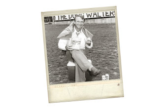 Cricketer Doug Walters eats a pie and sits on an Esky near the Hill at the SCG in 1981 to promote a book, The Doug Walters Story.