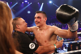 Tim Tszyu celebrates with his trainer after defeating Dennis Hogan in Newcastle.