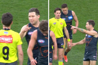 """TobyGreeneand the umpire """"bump"""" during the elimination final."""