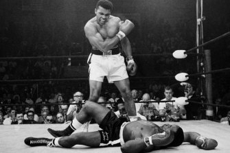 May 1965: Neil Leifer's famous photo of Muhammad Ali standing over Sonny Liston in their world title rematch.