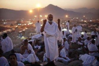A pilgrim prays atop Mount Arafat during the Haj.