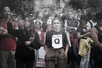 A young woman wearing a QAnon shirt during protests against COVID-19 restrictions on August 29 in Berlin.