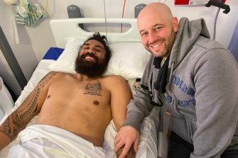 NRL chief executive Todd Greenberg visits Mose Masoe at Pinderfields Hospital in Wakefield in February.