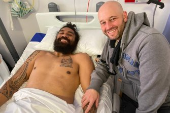 Former NRL chief executive Todd Greenberg visits Mose Masoe at Pinderfields Hospital in Wakefield last year.