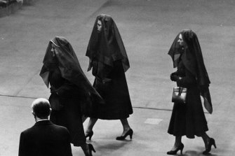 Queen Elizabeth, the Queen Mother, Queen Elizabeth II and Princess Margaret Rose wearing veils during their journey between Sandringham Castle and Buckingham Palace to attend the funeral of King George VI in February 1952.