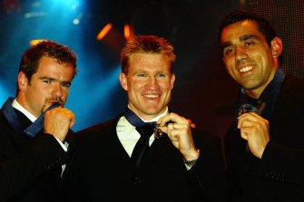 Nathan Buckley (centre), Mark Ricciuto (left) and Adam Goodes with their Brownlow Medals in 2003.
