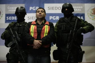 "Suspected Sinaloa cartel member Felipe Cabrera Sarabia, also known as ""El Inge"", is paraded before journalists in Mexico City in 2011."