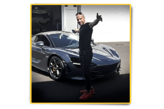 D'Amore and one of his luxury cars, a McLaren, shortly after purchase.