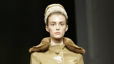 A model wears a coat with a fur trim from Prada's Fall-Winter 2010/2011 collection.