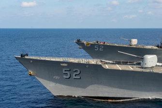 Rising tensions: US Navy ships pass through the South China Sea.
