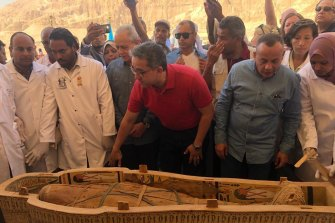 Egyptian Minister of Antiquities Khaled el-Anany, centre, reveals the details of 30 ancient wooden coffins recently discovered in the southern city of Luxor, Egypt.