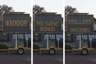 An electronic sign trailer outside the Diggers and Dealers conference in Kalgoorlie trying to attract new drillers offsiders with $1000 swing bonuses.