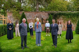 The Prince of Wales & YOOX Net-a-Porter group chairman Federico Marchetti with six of the Modern Artisans at the final collection review.