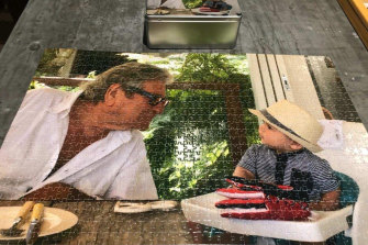 A jigsaw puzzle of Peter and his great-grandson, Oliver.