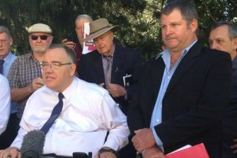 Former MP Rob Pyne (left) with Jason Ward at a protest outside the Queensland Parliament last July, calling for an ICAC for the state.