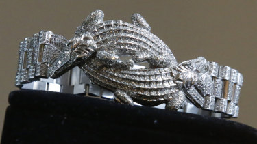 A men's bracelet made of 18K white gold and featuring two crocodiles entwined and covered with 1331 diamonds that featured in the auction.