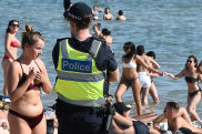 People enjoying St Kilda beach and the hot weather. Port Phillip Council last night voted to ban alcohol at St Kilda over the summer. Police patrolling the beach at St Kilda.