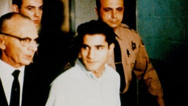 New evidence has emerged over the years that Sirhan Sirhan, in white shirt, may not have been the only shooter.
